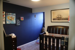 We love the paint color and the light from this little window in his reading nook.  The boat pen and ink is the mainstay in his room of the USS Constitution and thanks Mimi and Pops for the crib and Heather and Billy for all the bedding.  The America map came from Peggy and Bekah - thank you!  Can't wait to start traveling with the little guy!